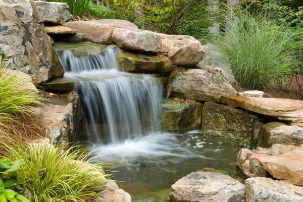Waterfall installed in backyard garden.