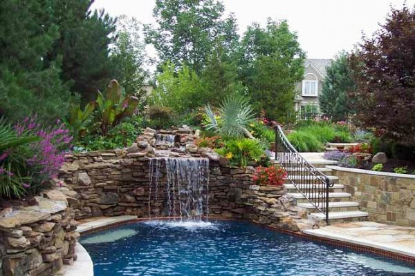 Pool with a rock and stone retaining walls on each side.
